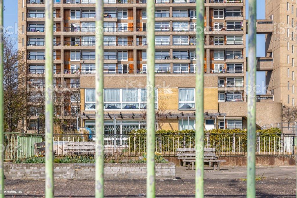 Council housing block in East London seen through bar fence stock photo