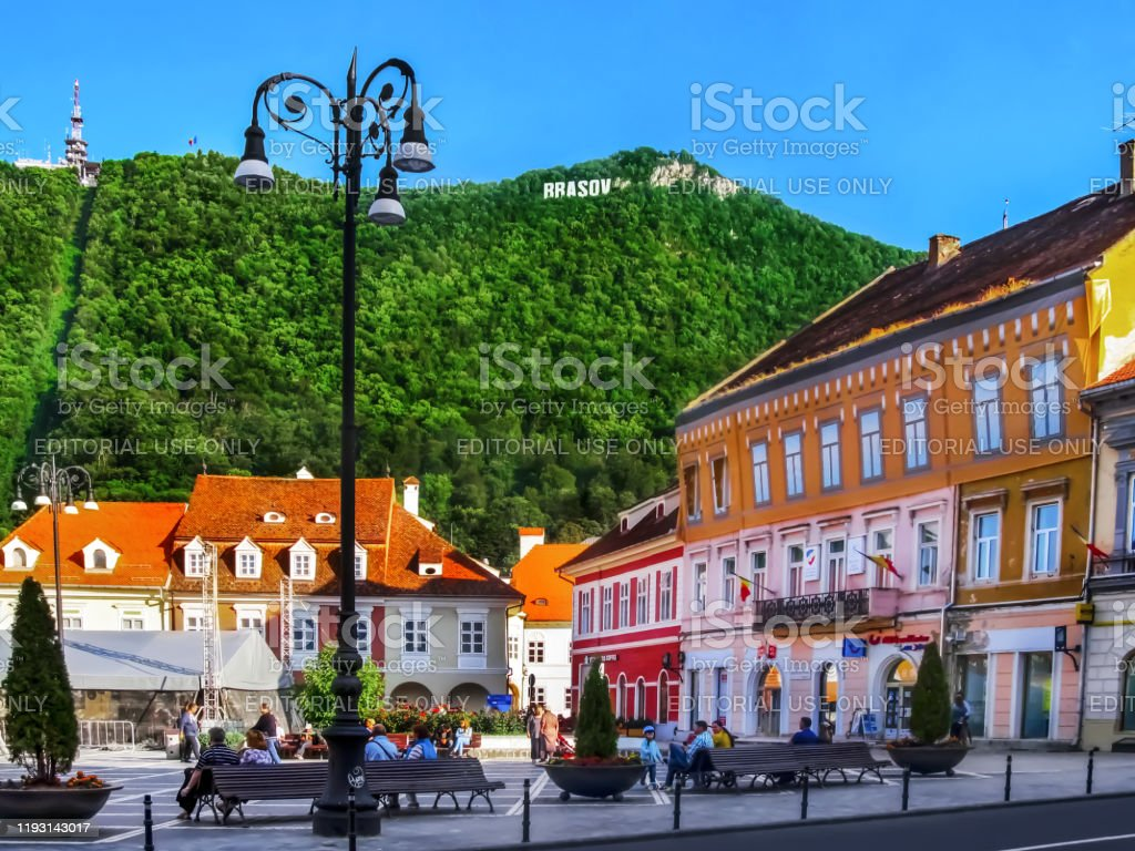 Council Square in Brasov and Mount Tampa with the name of the city on top Brasov, Romania - July 12, 2019: Council Square in Brasov and Mount Tampa with the name of the city on top. Colorful old town in the Romanian Carpathians, amazing landscape Architecture Stock Photo