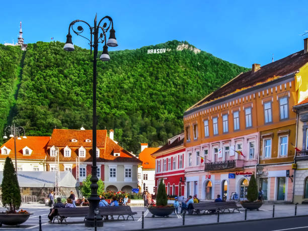 Council Square in Brasov and Mount Tampa with the name of the city on top stock photo