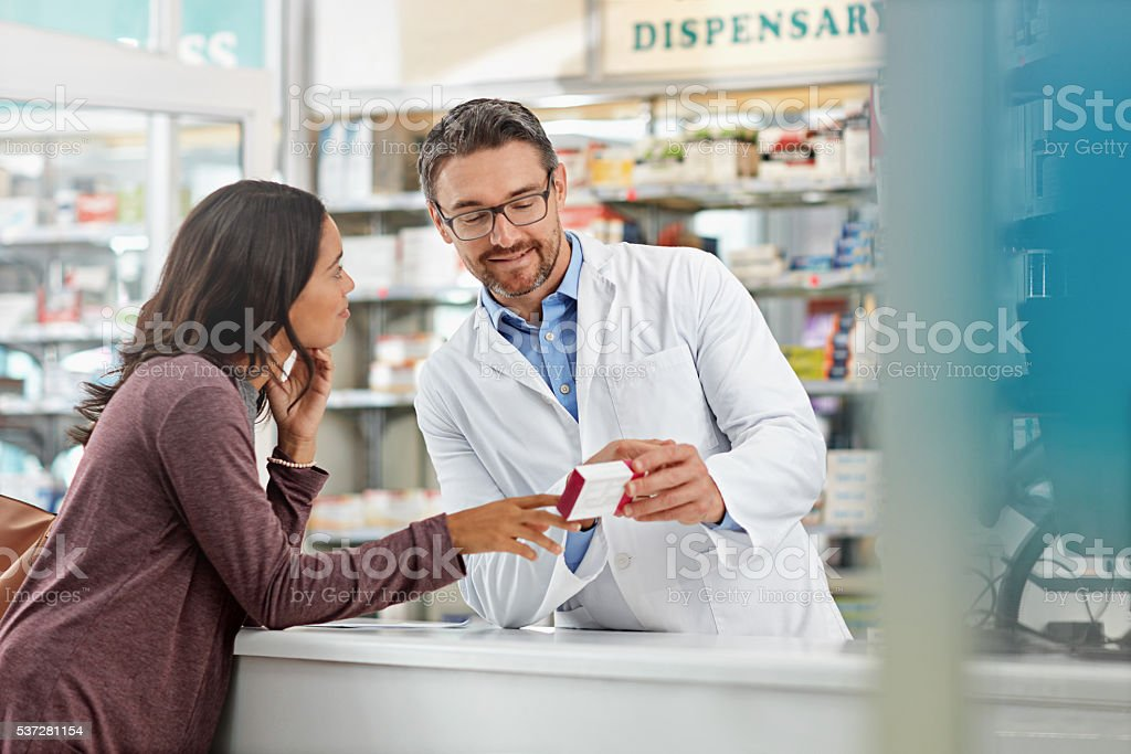 Counseling his patient regarding appropriate use of medication stock photo