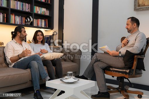 istock Counseling Session psychiatrist talking to couple client 1134991277