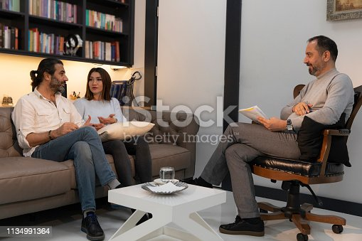1034426836 istock photo Counseling Session psychiatrist talking to couple client 1134991364