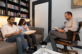 istock Counseling Session psychiatrist talking to couple client 1134991438