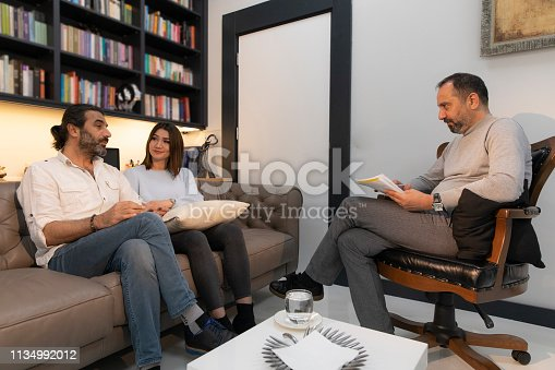 istock Counseling Session psychiatrist talking to couple client 1134992012