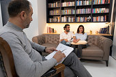 istock Counseling Session psychiatrist talking to couple client 1134992198