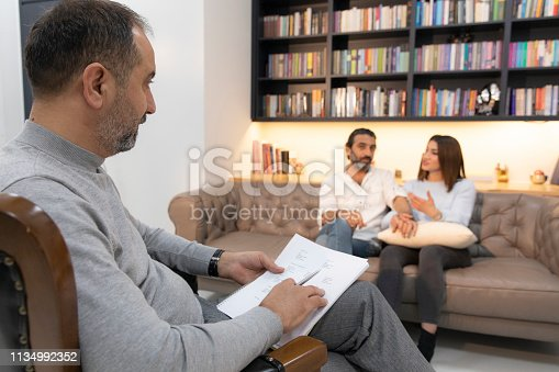 istock Counseling Session psychiatrist talking to couple client 1134992352