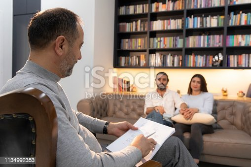 1034426836 istock photo Counseling Session psychiatrist talking to couple client 1134992353