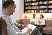 istock Counseling Session psychiatrist talking to couple client 1134992356