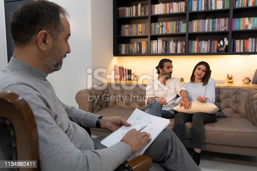 1034426836 istock photo Counseling Session psychiatrist talking to couple client 1134992411