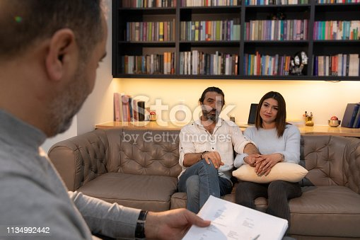 1034426836 istock photo Counseling Session psychiatrist talking to couple client 1134992442