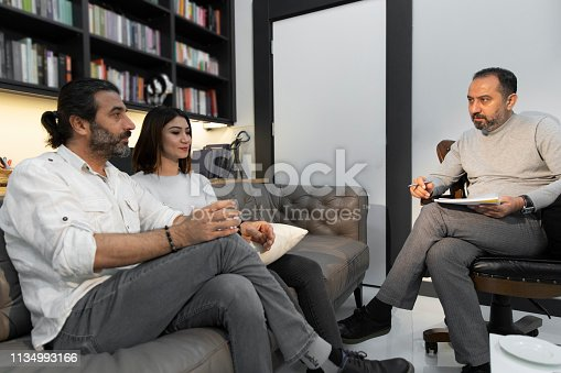 istock Counseling Session psychiatrist talking to couple client 1134993166