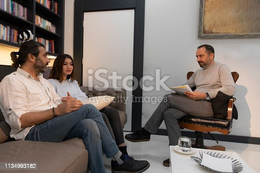 1034426836 istock photo Counseling Session psychiatrist talking to couple client 1134993182