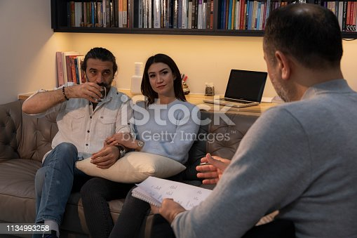 1034426836 istock photo Counseling Session psychiatrist talking to couple client 1134993258