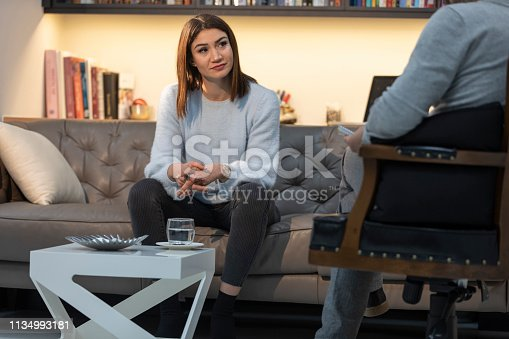 1034426836 istock photo Counseling Session psychiatrist talking to woman client 1134993181