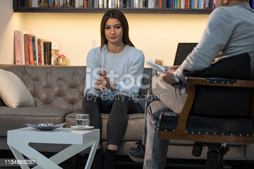 istock Counseling Session psychiatrist talking to woman client 1134993257