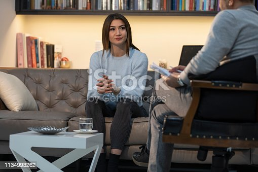 1034426836 istock photo Counseling Session psychiatrist talking to woman client 1134993262
