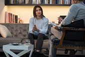 istock Counseling Session psychiatrist talking to woman client 1134993325