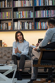 istock Counseling Session psychiatrist talking to woman client 1134993348