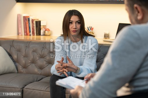 1034426836 istock photo Counseling Session psychiatrist talking to woman client 1134994072