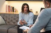 istock Counseling Session psychiatrist talking to woman client 1134994072