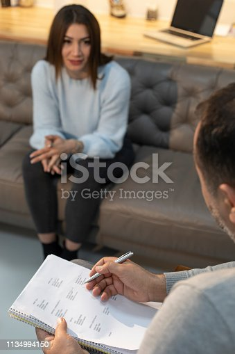 1034426836 istock photo Counseling Session psychiatrist talking to woman client 1134994150