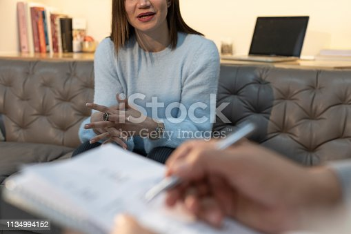 istock Counseling Session psychiatrist talking to woman client 1134994152