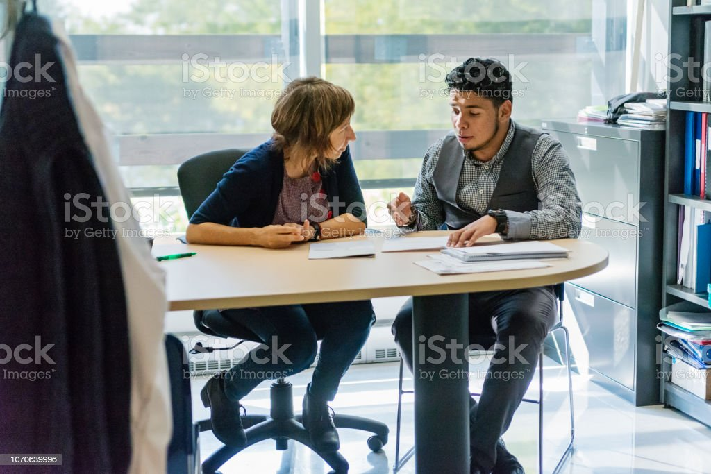 Counselling appointment for College student. stock photo