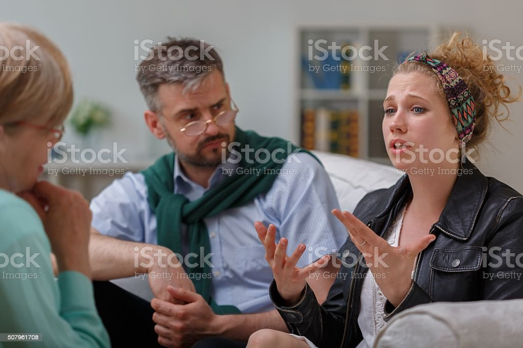 Counselor and couple with problem stock photo
