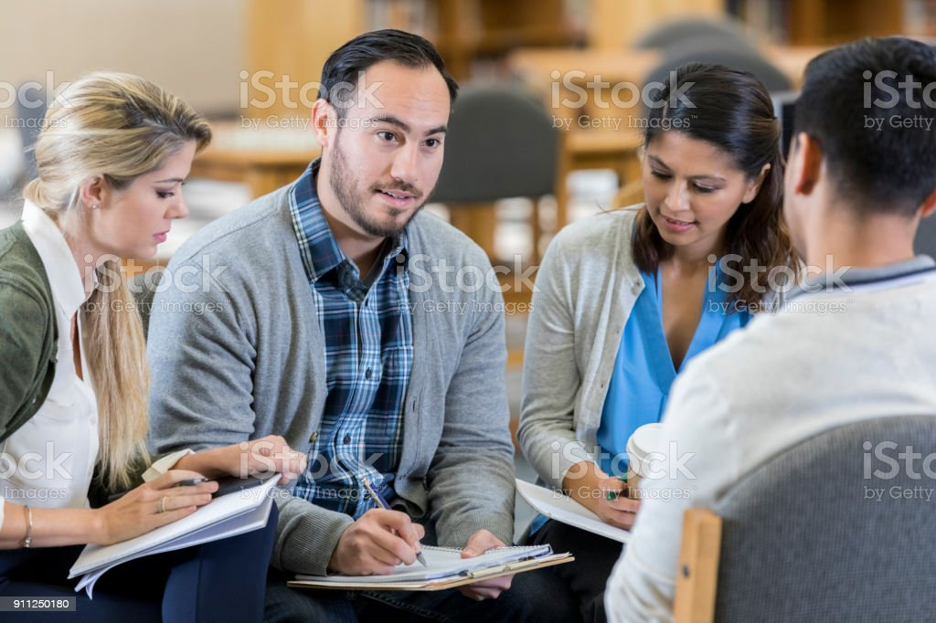Counselor facilitates group therapy session stock photo