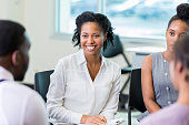 istock Counselor facilitates support group meeting 868584282