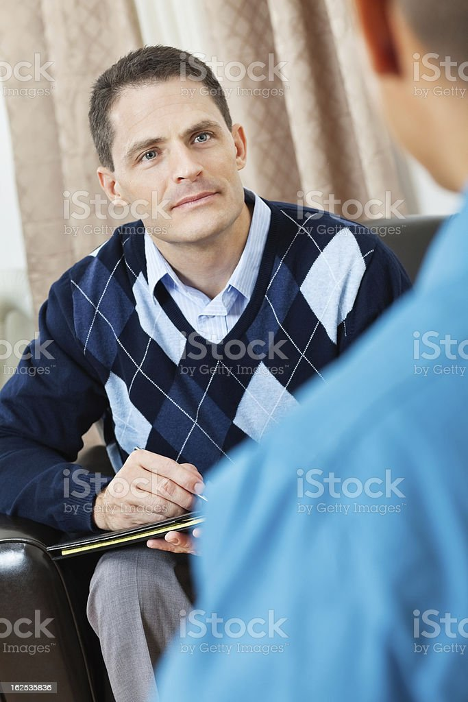 Counselor listening to patient or co-worker royalty-free stock photo