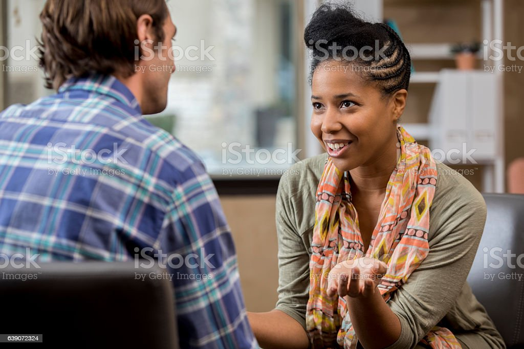 Counselor meets with male patient - Photo
