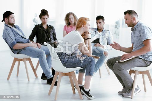 istock Counselor talking with rebellious girl 901225240