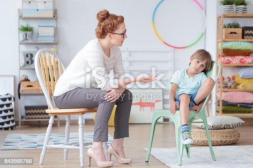 istock Counselor talking with worried boy 843565766