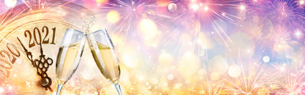 2021 Countdown - Champagne And Clock for New Year Celebration stock photo