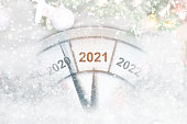 istock Countdown to midnight. Clock of holiday counting last moments before Christmas or New Year 2021. 1270627025