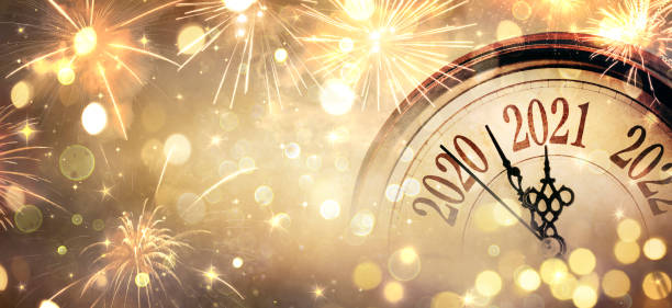 Countdown To Midnight - Happy New Year 2021 - Abstract Defocused Background - Clock And Fireworks stock photo