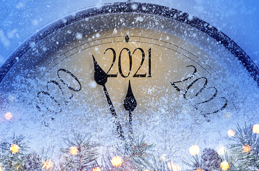 Countdown to midnight. Retro style clock counting last moments before Christmas or New Year 2021.