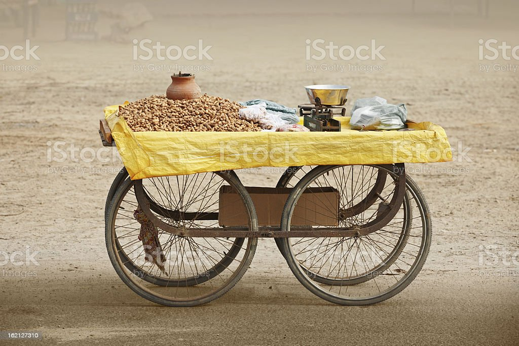 Counter to sell roasted peanuts. India. stock photo