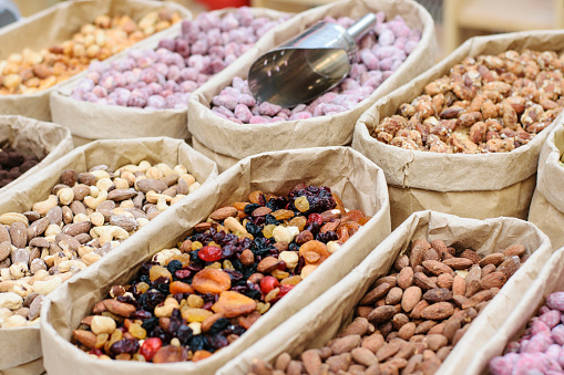 A counter with an assortment of delicious nuts.