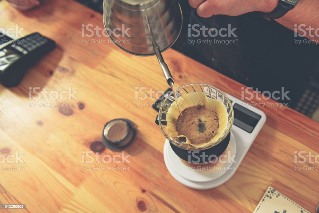 Counterman making flavored tea for client stock photo