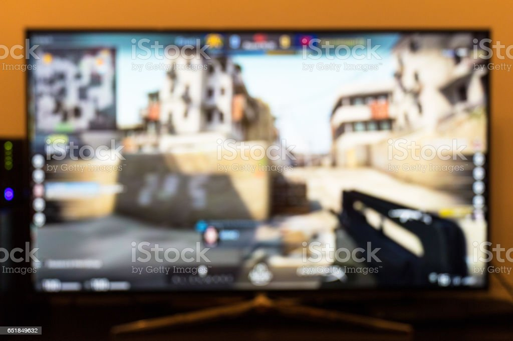 Counter-strike professional game on tv and remote control royalty-free  stock photo