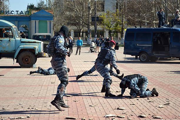 counter-terrorist show Kherson, Ukraine - April 22, 2013: anti-terrorist special units show their skills at the show on April 22, 2013 in Kherson. Ukrainian special units actively participate in UN peacekeeping operations. antiterrorist stock pictures, royalty-free photos & images