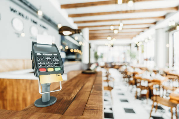 counter-top payment terminal in a restaurant - station stock pictures, royalty-free photos & images
