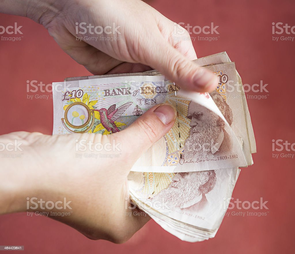 Counting British Money stock photo