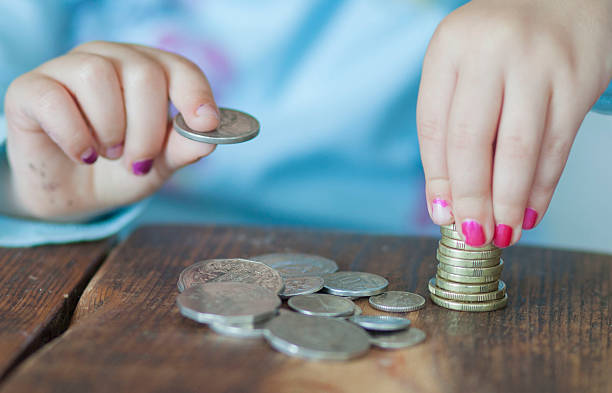 Counting coins stock photo