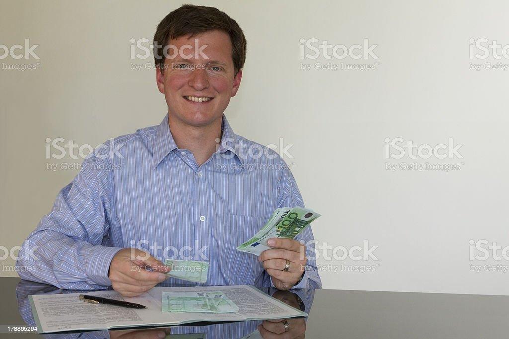 Counting Euros (horizontal) royalty-free stock photo