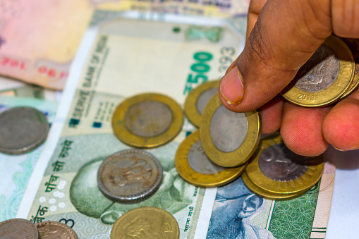 counting money and old coins. Save money for the future. d old coins. Saving money and account finance bank business concept.