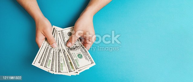 Man counting money, economy concept, allocation of money