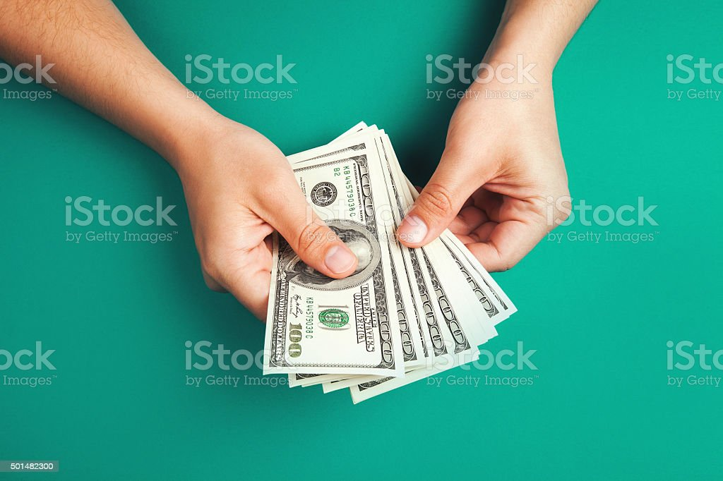 Counting money with hands stock photo